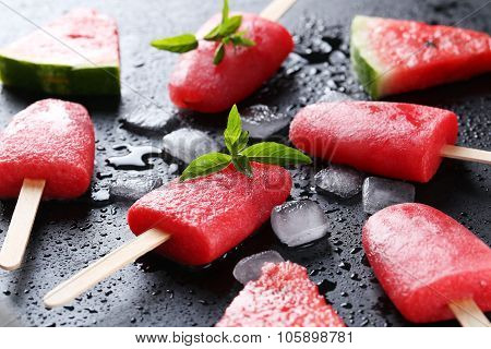 Watermelon Popsicle On The Black Wooden Table