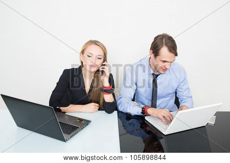 man and woman handcuffed. working in the office for notebooks