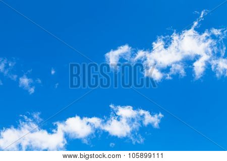 Ragged White Clouds In Blue Sky In Autumn Day