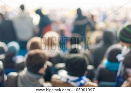 Blurred Crowd of People On stadium or ather populous place, unrecognizable crowded population as blu