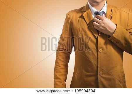 Businessman Putting On A Necktie