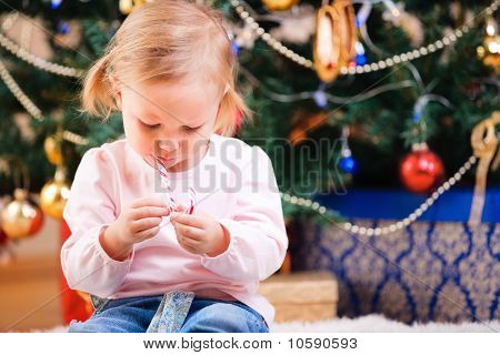 Toddler Girl With Christmas Candy