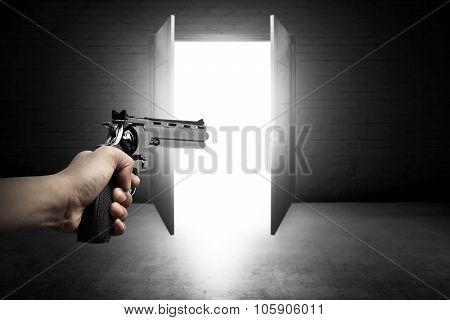 Man Hand Aiming Gun