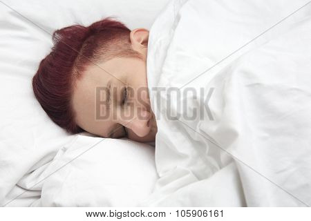 Red-haired Woman Sleeping In Bed