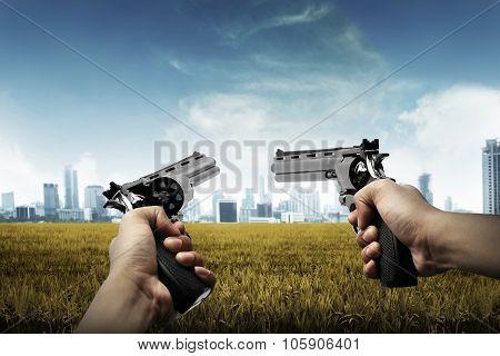 Man Hand Holding Two Gun