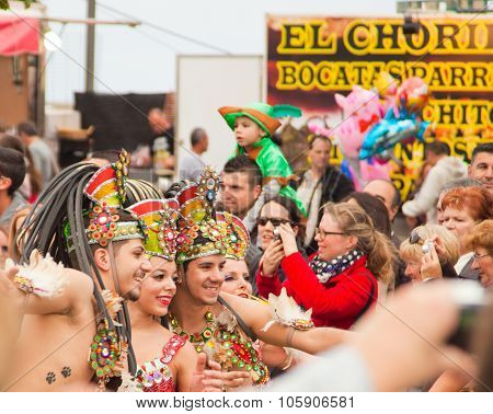 Santa Cruz, Spain - February 12: Parade Participants In Colorful Costumes March Through The Streets