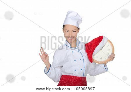 Smiling Asian Chef With Clock And Christmas Hat