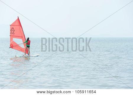 Windsurf - Surfer Girl On Blue Sea Surface