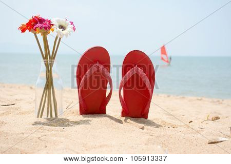 Red Old Slippers And Flower On The Beach With Windsurf Background