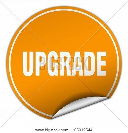 Upgrade Round Orange Sticker Isolated On White