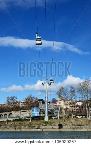 Tbilisi Funicular - Air Cableway Against The Blue Sky