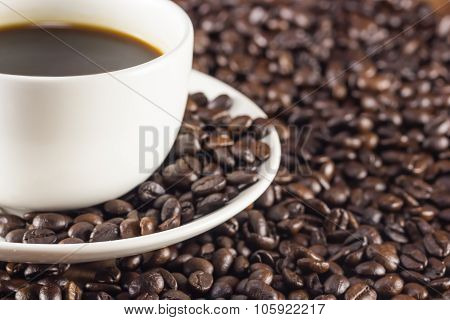 A Cup Of Coffee And Coffee Beans Background Warm Toning, Selective Focus