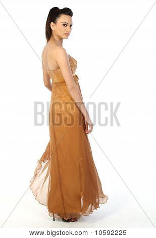 Indian bride with golden color long gown