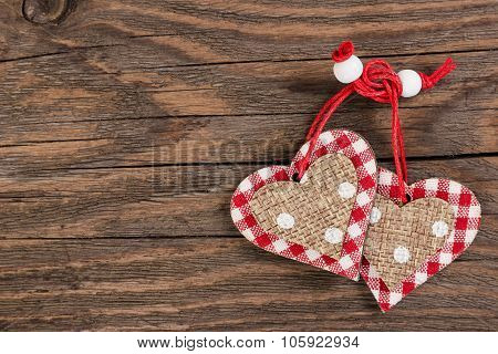 Decorative Hearts On Wooden Background.