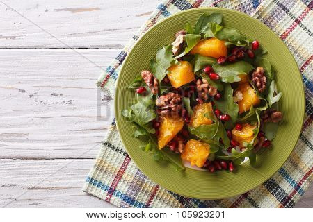 Salad With Pomegranate, Oranges, Arugula And Nuts. Horizontal Top View