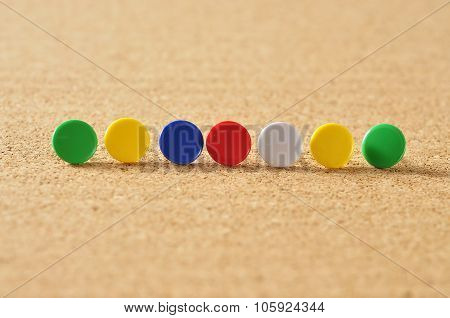 Close Up of Colorful Push Pins On Board, Selective Focus