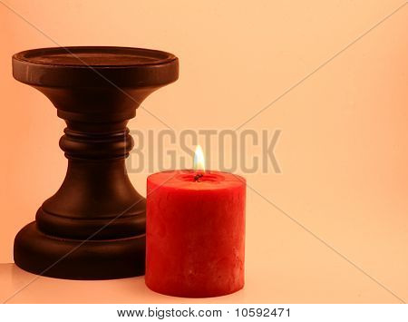 Red Candle and Black Candleholder
