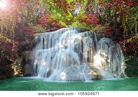 Beautiful Scenic Of Waterfall With Autumn Forest.