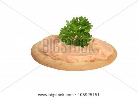 isolated salmon pate on cracker
