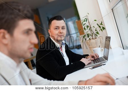 Two Men Working In Startup Center