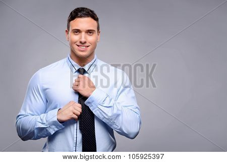 Pleasant man getting dressed
