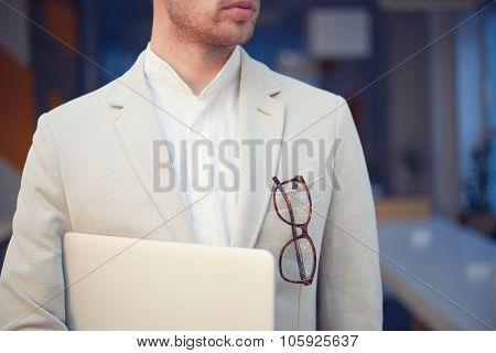 Closeup Of Stylish Employee With Laptop