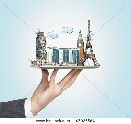 A Man's Hand Holds A Tablet With Sketches Of The Most Famous Places In Italy, Great Britain, France