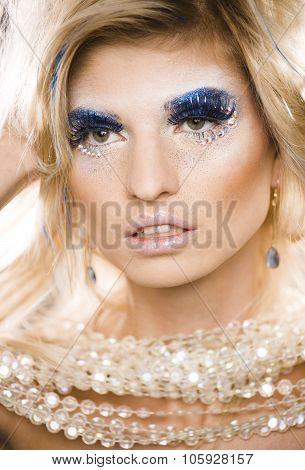 beauty blong woman ith make up, winter tinsel shining close up