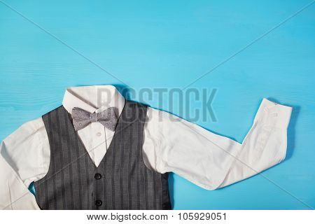 White Shirt, Gray Vest And A Bow Tie