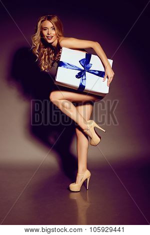 Sexy Charming Naked Woman  Holding A Big Present