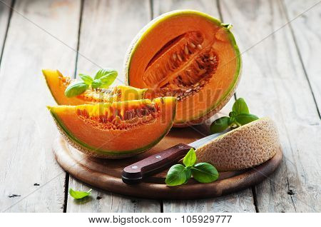 Sweet Fresh Melon On The Wooden Table