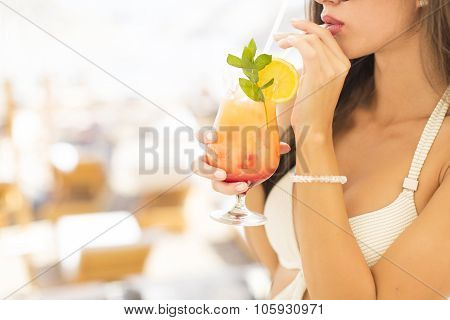 Young Woman With Coctail On The Beach