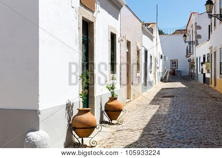 Narrow european street in a sunny day, Portugal