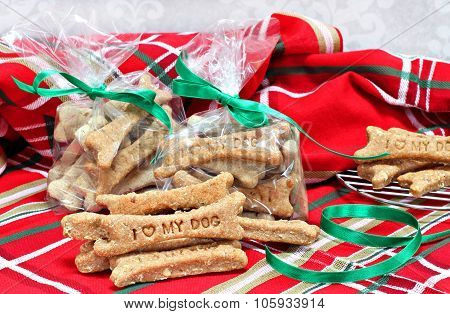 Homemade Dog Biscuits Stamped With I Love My Dog In Christmas Setting.