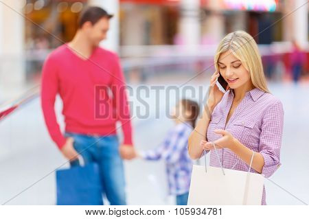 Positive family walking in the mall