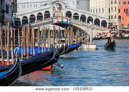 Rialto Bridge And Gondole, Venice - Italy