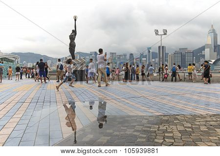 Hong Kong, China - August 14, 2015: Tourists Walking Near The Bronze Statue Of Hong Kong Film Awards