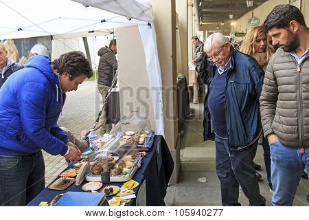 Moncalvo, Italy - October 18,2015: Tourists In Front Of A Truffles Vendor At The Truffle Fair Of Mon