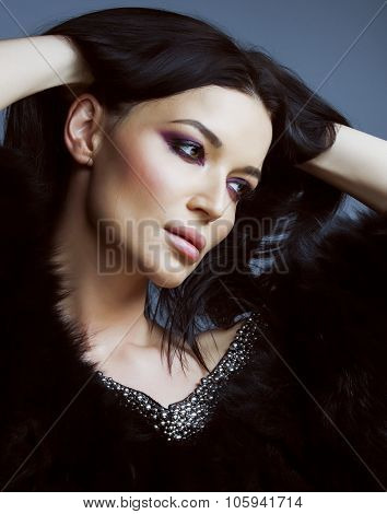 young pretty brunett woman dressed stylish in fur close up luxury seductive wealth