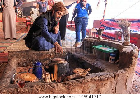 Wadi Rum, Jordan - March 24,2015: Bedouin Serving Tea To The Tourists Visiting The Bedouin Camp In T