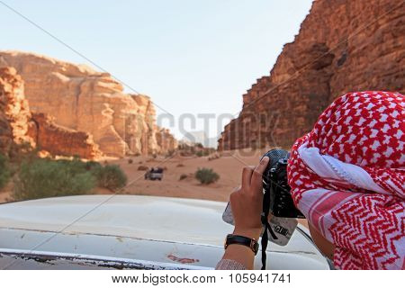 Wadi Rum, Jordan - March 24,2015: Tourist Taking Picture From A Car Driving Through The Wadi Rum Des