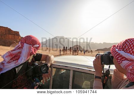 Wadi Rum, Jordan - March 24,2015: Tourists Taking Picture From A Car Driving Through The Wadi Rum De