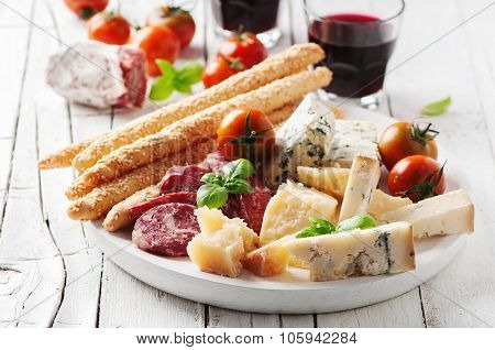 Concept Of Italian Antipasto With Cheese And Sausage