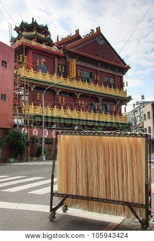 Asian Noodles In Front Of A Temple