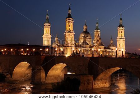 View Of The Basilica Of The Virgen Del Pilar And Ebro River, On The Right Is Located The Medieval Br