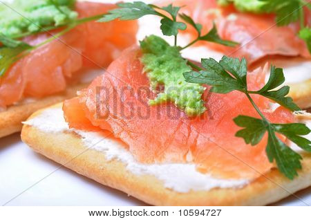 Smoked Salmon With Wasabi  On Cracker Isolated