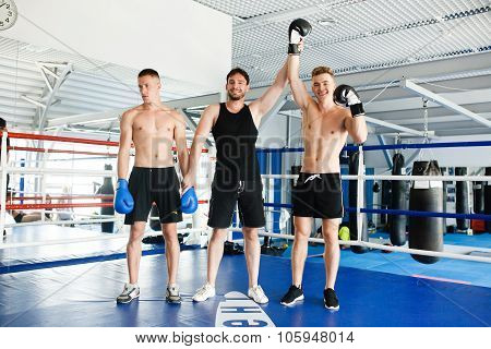 Strong boxer and opponent during a box fight in ring