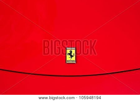 Ferrari logo on a red car
