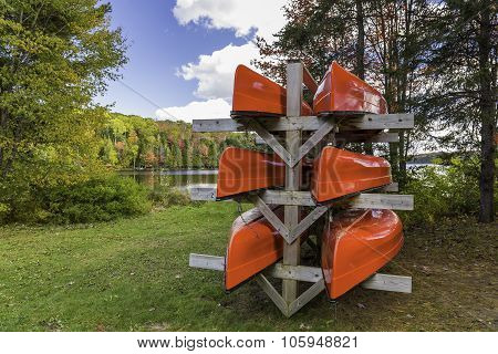 Red Canoes On A Rack