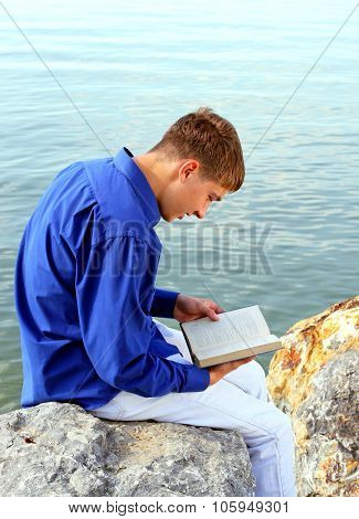Young Man With A Book Outdoor